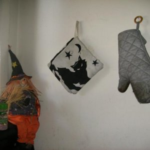 The witch on the corner, my black cat pot holders.