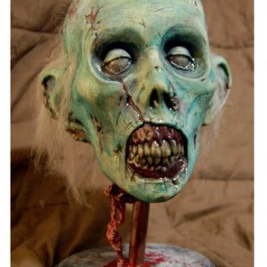 This is the same guy as Bernie and the rest of the ghouls in my graveyard. A slush cast of a sculpt I did years ago. I painted it with cheapo acrylics