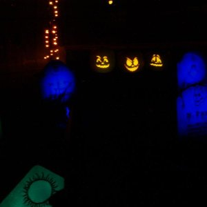 My singing pumpkins are sitting in front of my pneumatic toepincher coffin.