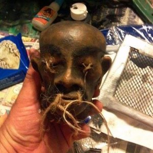 shrunken head - Duct tape Ball and neck covered with layers of tissue mache and paper clay.