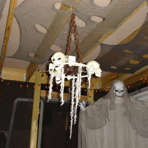 skull chandelier lights up and laughs, and jaws move