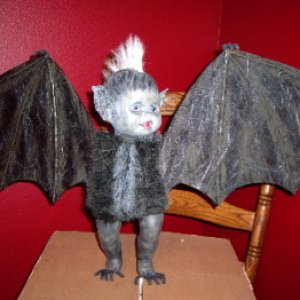 I added black fur to his body, with a little white stripe down the front, and little claws to the tips of the wings.