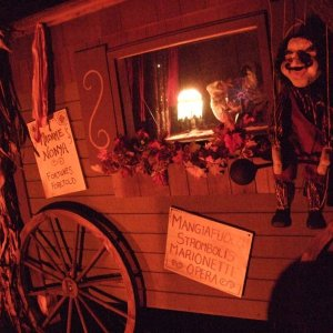 Our gypsy wagon got a Pinnochio twist this year.  We kept the gypsy with her Big Scream tv crystal ball, but added Mngiofuoco/Stromboi's marionettes (
