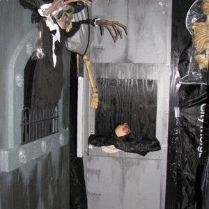 morgue doors with shaking head body bag