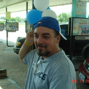 Curious what I look like?  Posing with balloons at a Sonic fundraiser for the local high school.  I'm not big on having my picture taken.  So don't ex