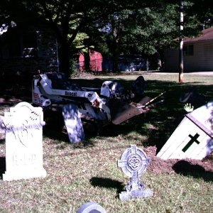 You know you got it bad when you start bringing in the heavy equipment to help decorate your graveyard !!