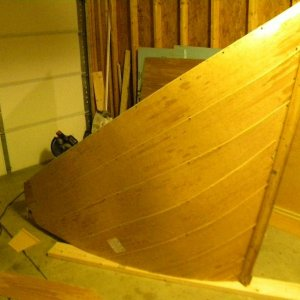 Skinning the shipwreck with thin wood.
