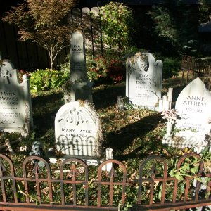 Cemetery with headstones made from foam, PVC candles and plastic/wood/PVC fence