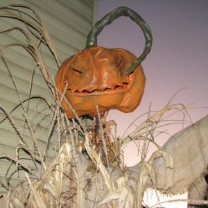 pumpkinhead - old version. Still have this one though. Held up for several years, including an early snow storm. Yes...it is paper mache. When treated